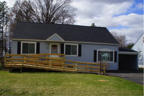 house with wheelchair ramp built in front of it