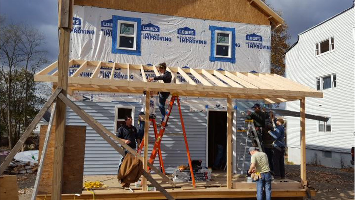 people constructing a home
